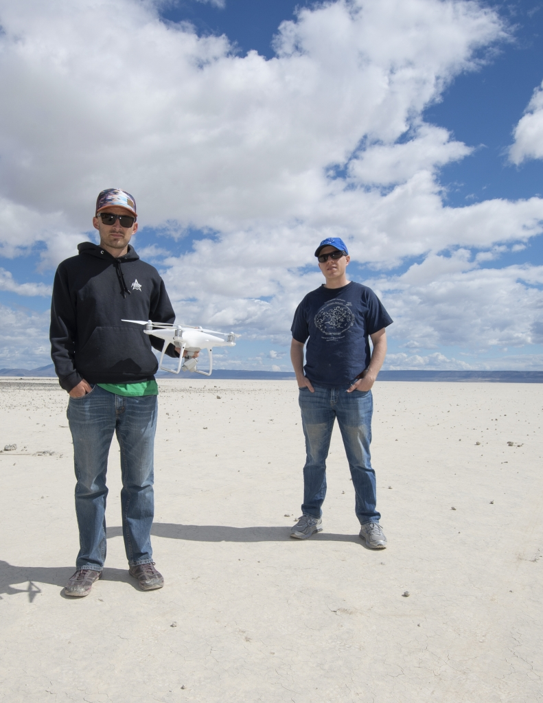 Researchers standing in Oregon desert with drone