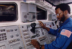 Dr. Ronald E. McNair at the controls in a space shuttle.