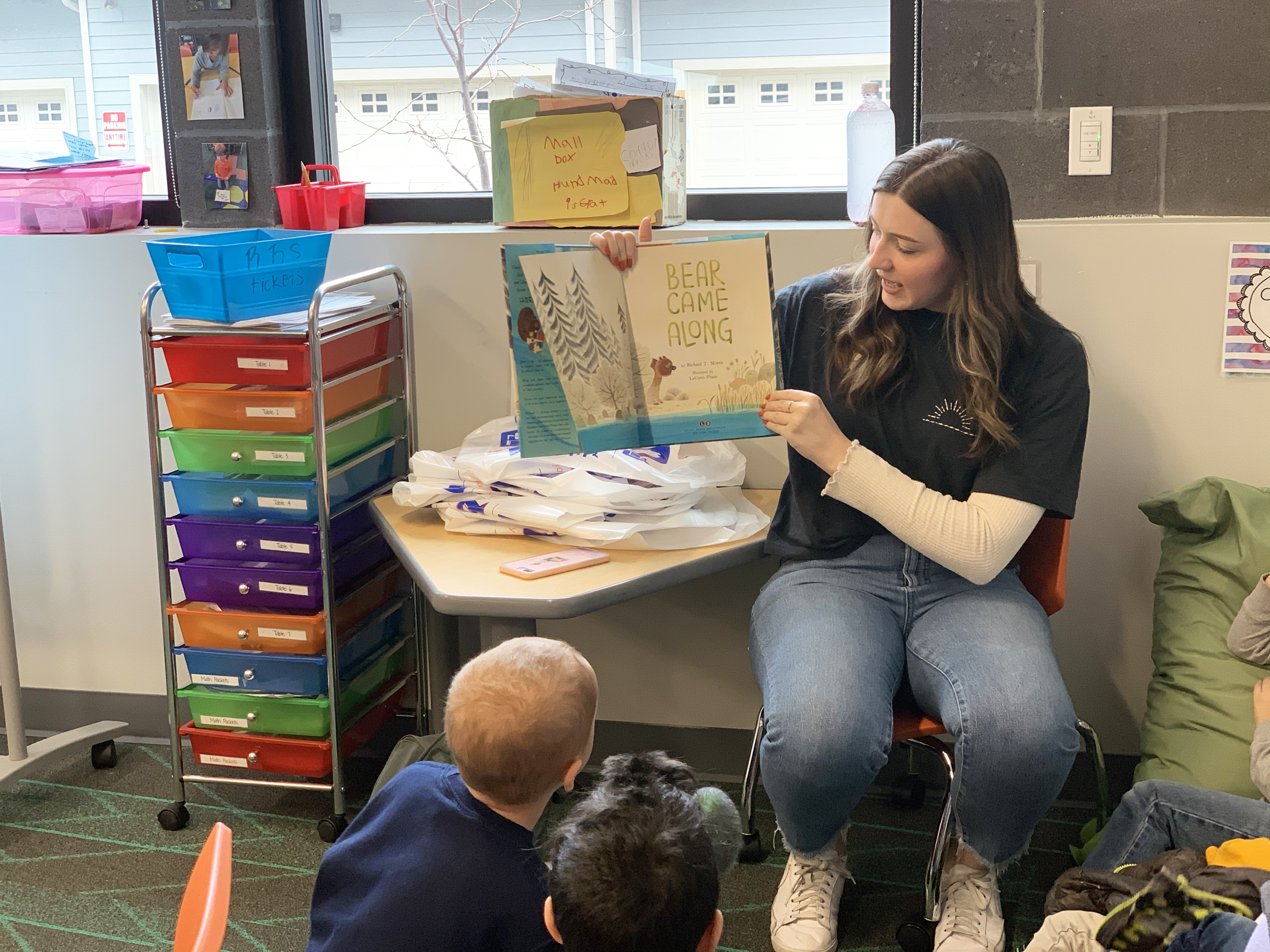 Carissa Schlachter reads a book to elementary students