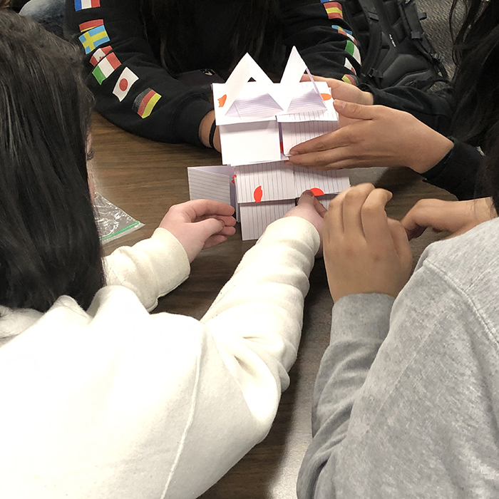 Students create a structure with cards