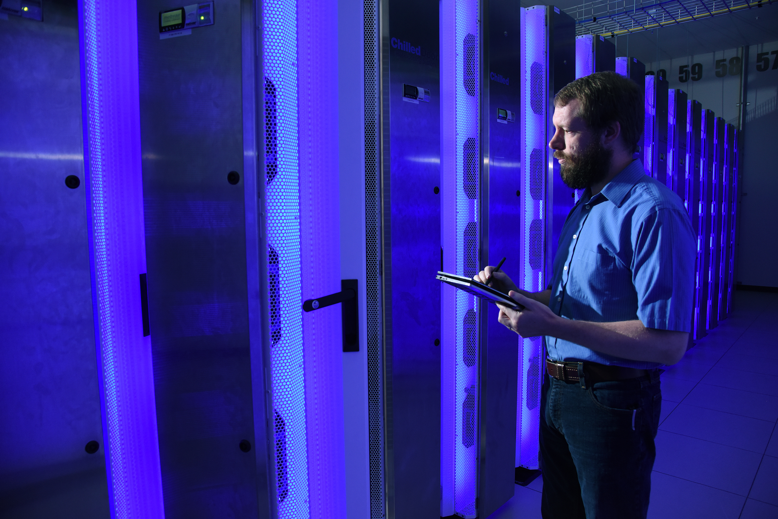 HPC Personnel Looking at Supercomputer
