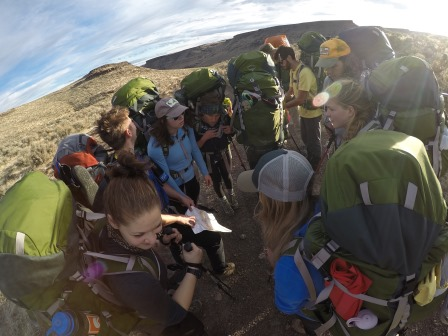 Group of students prepping for hike