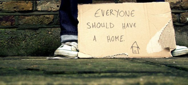 Cardboard sign with text everyone should have a home