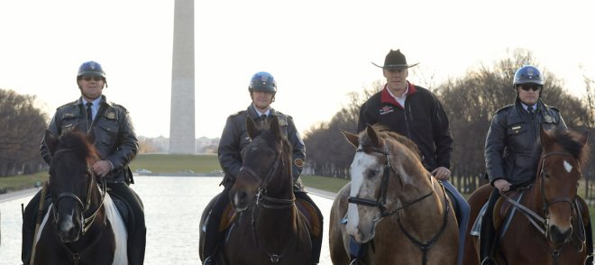 Photo of Secretary of Interior Ryan Zinke arriving for his first day of work on horseback. ior.
