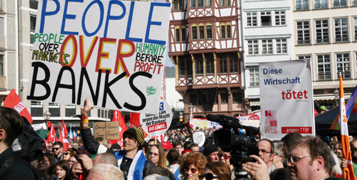 Image of protestors protesting bank bailout