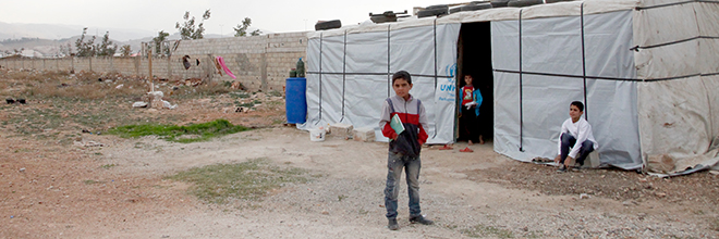 Syrian children outside temporary home in Lebanon's Bekaa Valley