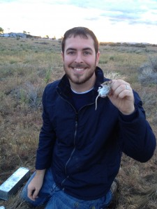 Photo of Shawn H. Smith with a prairie mouse