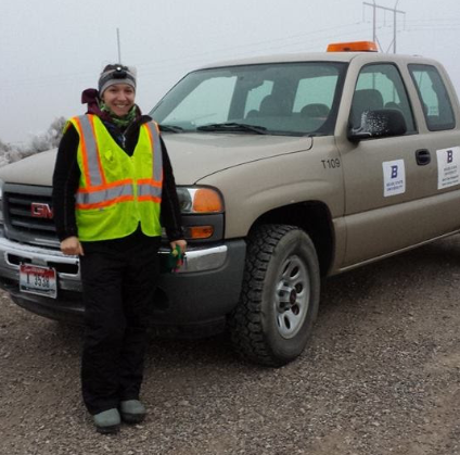 Photo of Tempe Regan and Raptor Research Center truck, ready for fieldwork