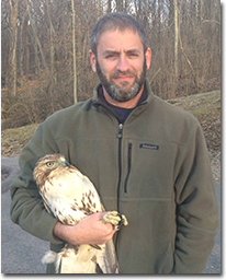 Todd Katzner with bird in hand