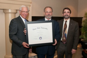 Dr. Marc Bechard (center) receives the Distinguished Professor Award from Boise State University President Dr. Bob Kustra and Provost Dr. Martin Schimpf at a reception held on Wednesday, March 20, 2013 (photo by J. Kelly, BSU Photographic Services)