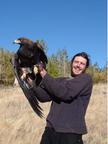 Photo of Rob Spaul holding a Golden Eagle
