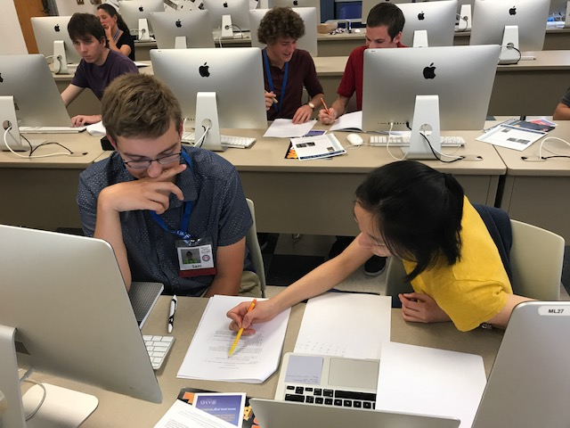 Students working with computer and notebook