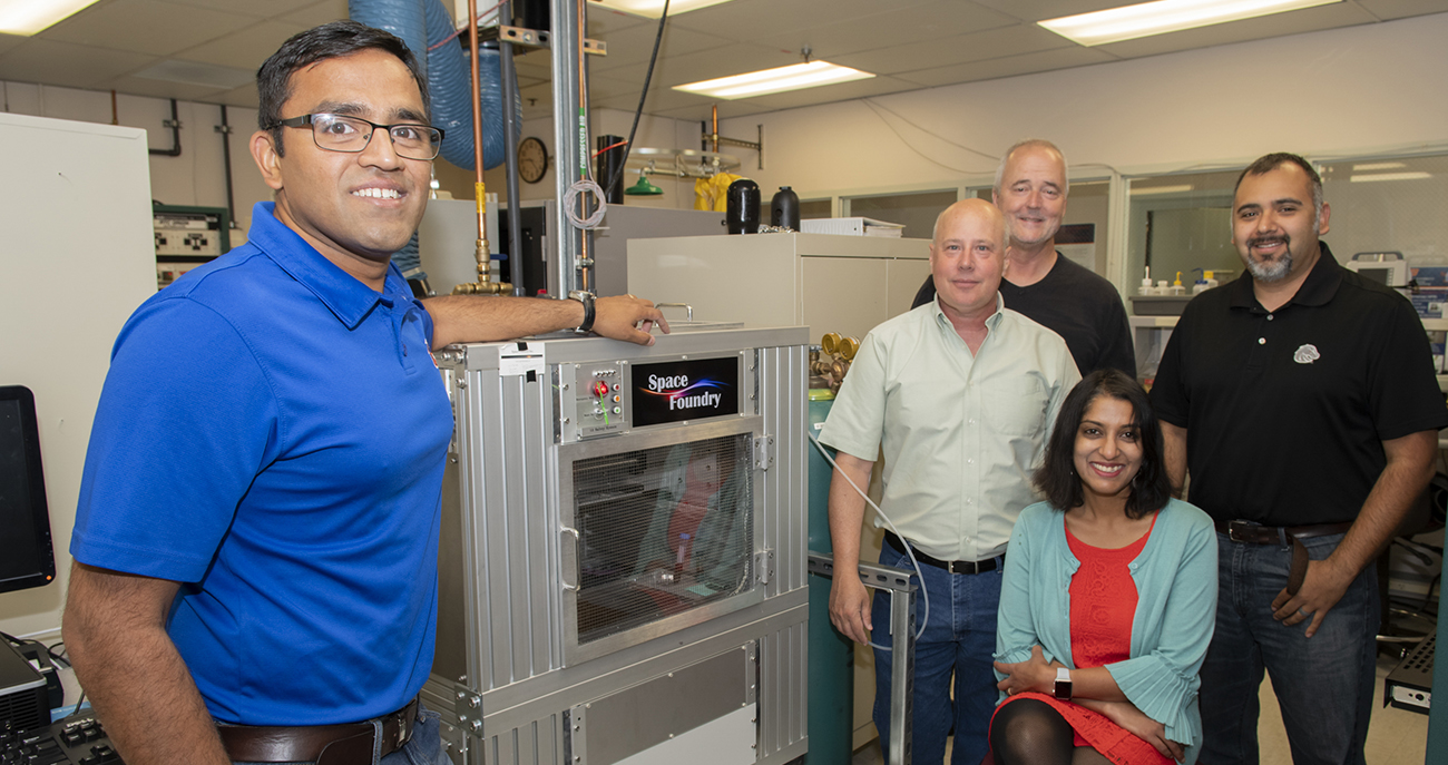 Harish Subbaraman (left) with Jim Browning, Ken Cornell, David Estrada and Nirmala Kandadai pose with a plasma printer in a Ruch building COEN lab