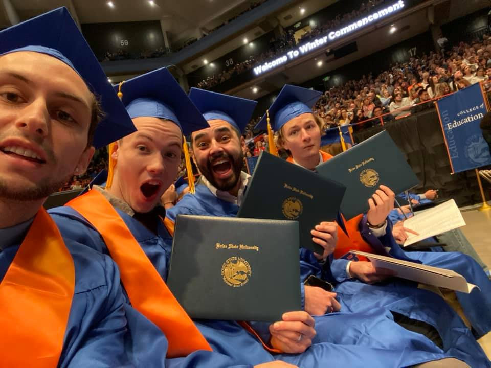 ME students pose with their diploma covers at Winter Commencement 2019