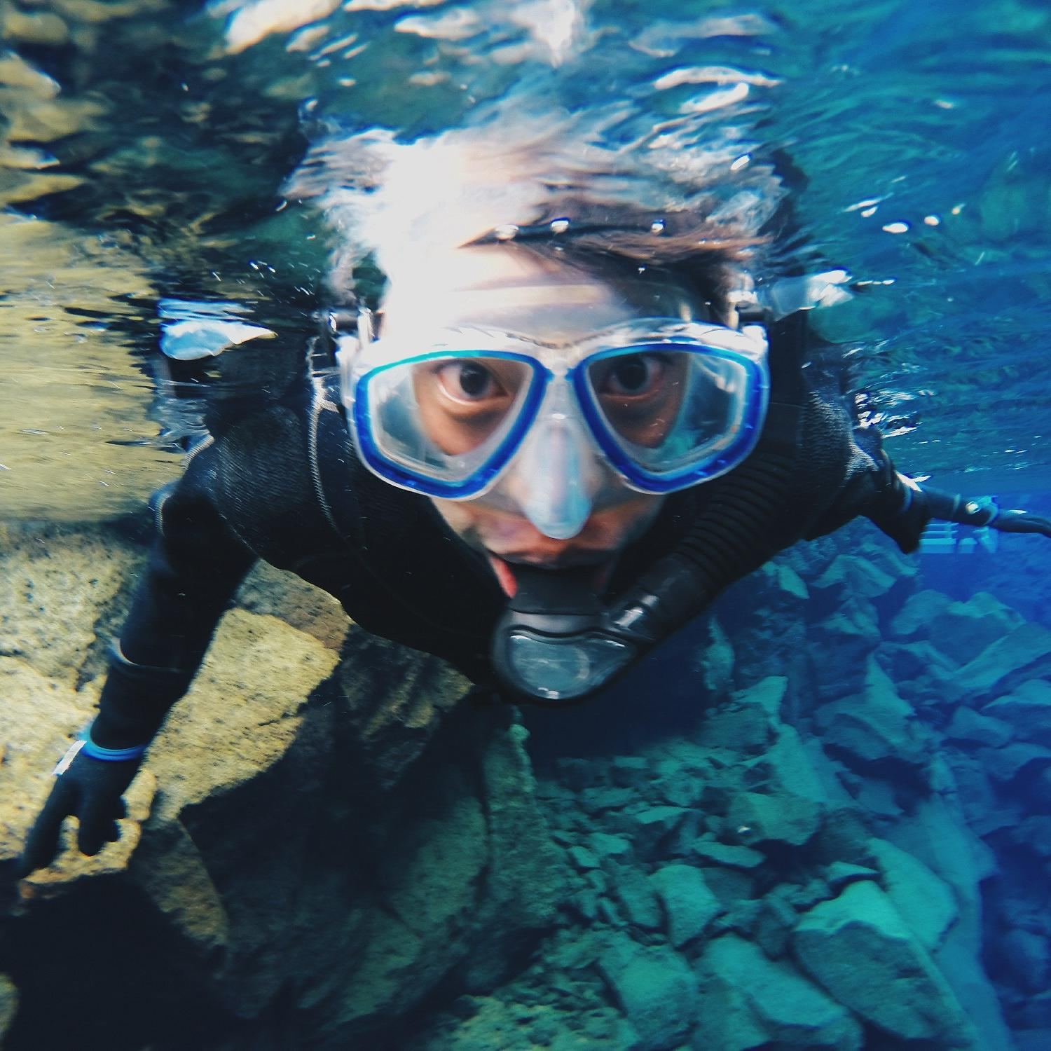 Male student snorkeling in Iceland