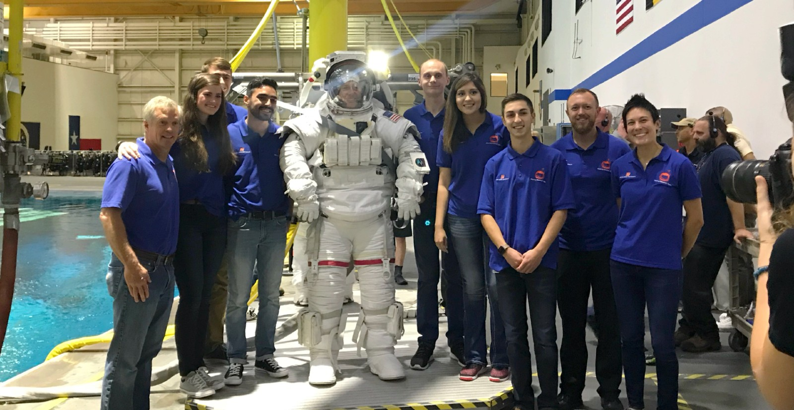 students at the NASA Johnson Space Center pose with astronaut
