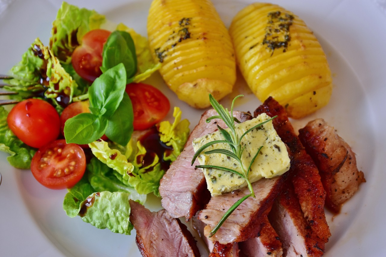 a healthy meal with meat, potatoes and salad