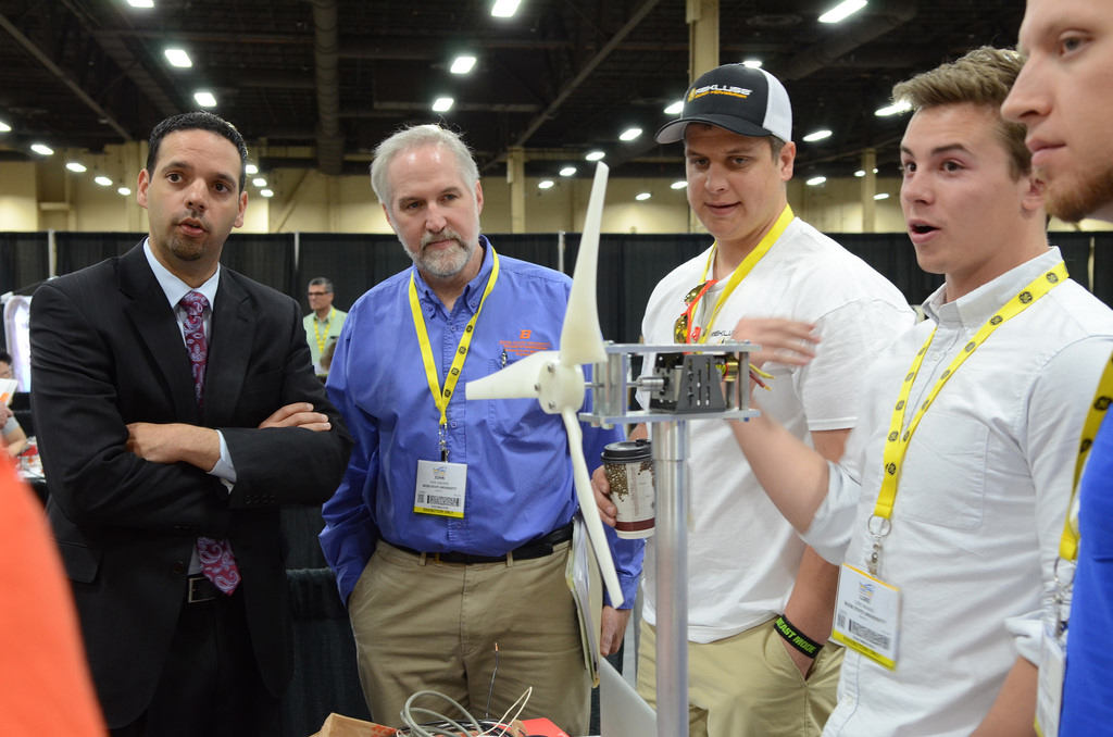 students explain their wind turbine model to judges