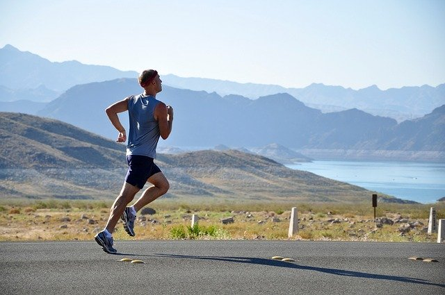 male runner on a scenic road
