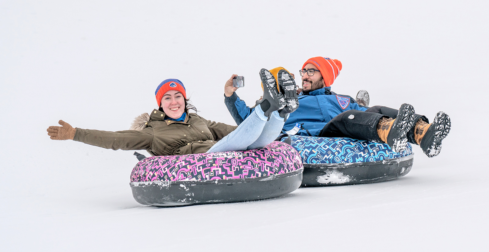 Students on inner tubes in the snow