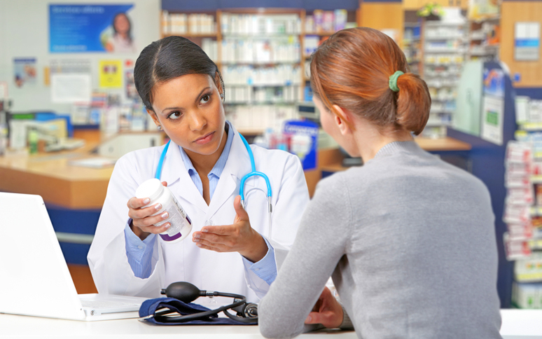 pharmacist assisting a patient